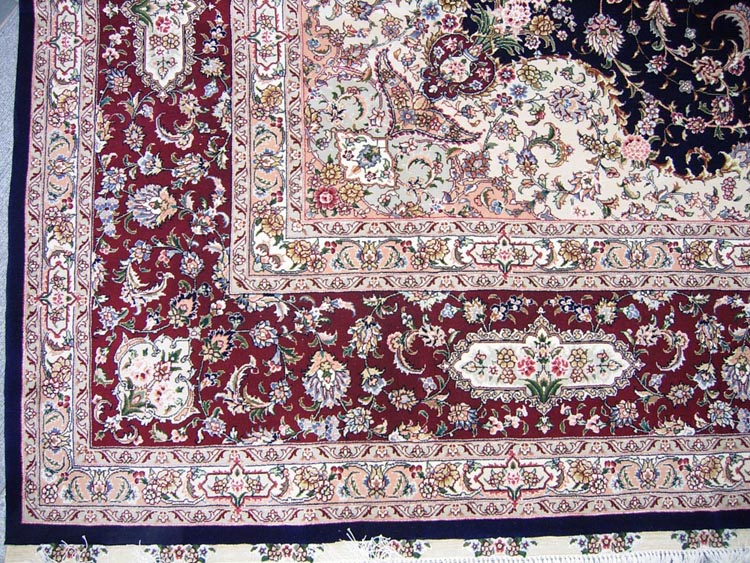 silk and wool carpet red border