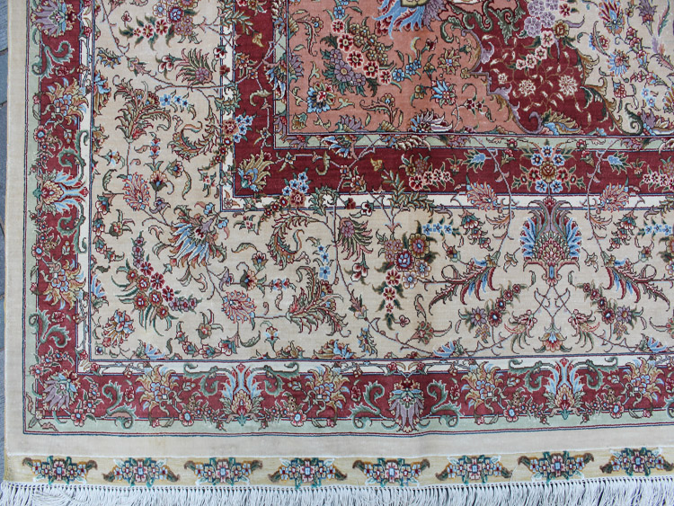 picture of one corner of persian silk rug