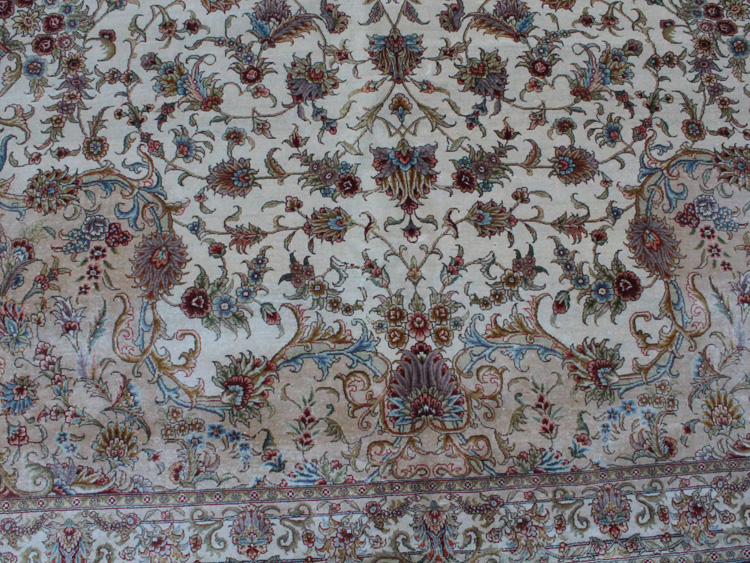 white field on Tabriz silk rug
